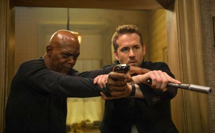 Ryan Reynolds y Samuel L. Jackson en una escena de acción